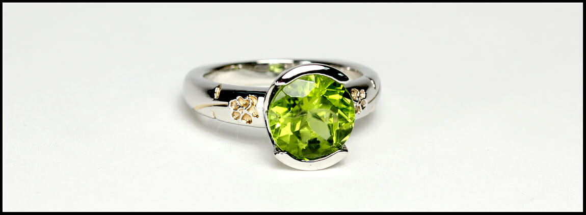 Pansy flower custom peridot engagement ring in platinum with 24K gold inlay